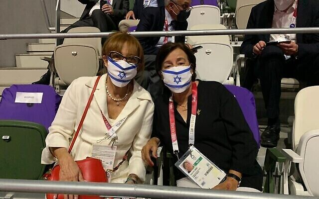 Ankie Spitzer and Ilana Romano, widows of Andre Spitzer and Yoseff Romano, who were murdered in the 1972 Munich massacre, take part in the Tokyo 2020 Olympics opening ceremony, July 23, 2021 (Courtesy)