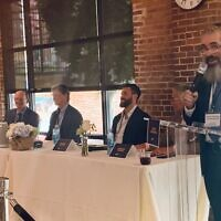 Panelists A.J. Robinson, Nick Imerman, Nat Kaplan and Norman Radow applauded Rabbi Eliyahu Schusterman's success in real estate ventures.
