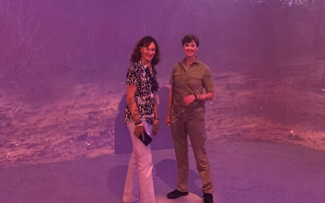 """Sandy Bailey chatted with Illuminarium staff after waves """"rushed"""" the floor at a Serengeti sunset."""