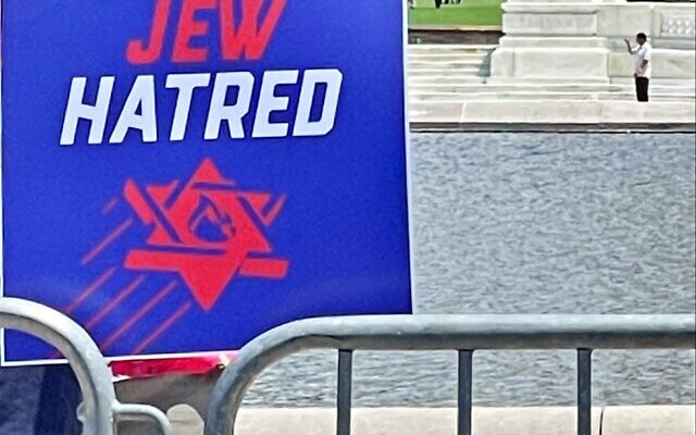 """""""End Jew Hatred"""" poster is among those signs at the rally combating anti-Semitism."""