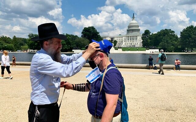 Taking pride in the act of tefillin in front of the Capitol.