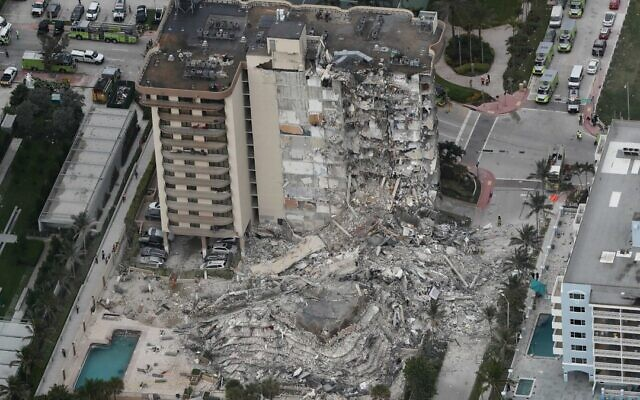 Aerial photo shows part of the 12-story oceanfront Champlain Towers South Condo that collapsed in Surfside, Fla. Photo by Amy Beth Bennett/South Florida Sun-Sentinel via AP