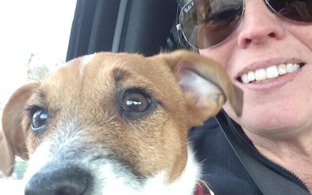 Rachel Gilman Thompson with a dog she cares for through a similar pet outreach program.