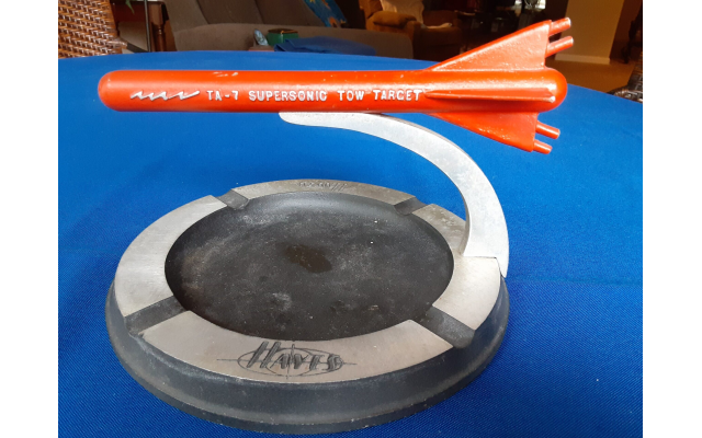 Patented, rare, figural ashtray depicts a towed, in-flight aircraft refueler.
