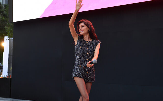 Noam Galai / Getty Images for Elite World Group // Julia Haart welcomes the crowd at the New York premiere. Her skimpy attire drives home the point of the series.