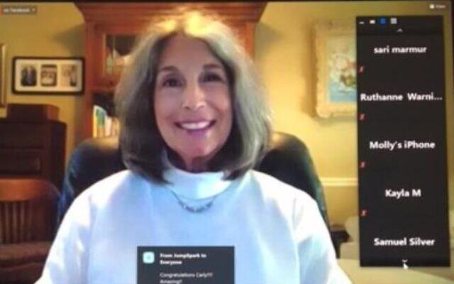 Phyllis M. Cohen announces the Leadership Award Essay Contest winner.