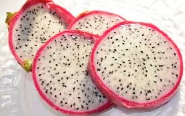 Raw cut-up dragon fruit is ready for tasting.