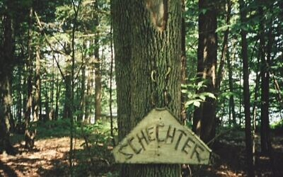"""A homemade sign welcomes family and friends to """"Camp Schechter"""""""