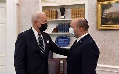 Prime Minister Naftali Bennett, right, speaks as he meets with US President Joe Biden in the Oval Office of the White House, Friday, Aug. 27, 2021, in Washington. (GPO)