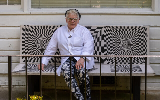 Photo by Howard Mendel Photography//  Marcia enjoys the black and white Op Art design bench she created for ING Financial. Note her self-designed black-and-white eyewear.