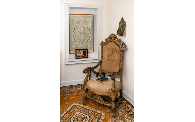 Photo by Howard Mendel Photography  // This shabby-chic throne commands the corner of Cohen's living room.