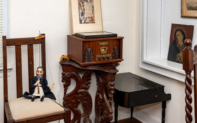 Photo by Howard Mendel Photography  // This eclectic grouping of treasures from Cohen's travels includes a rabbi marionette from Prague, a Mexican retablo, and a nostalgic phonograph to play her Yiddish 78 rpm records.
