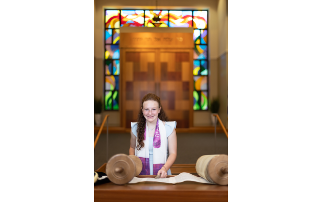Photos by Revelry Photo House// Emily, reading from the Torah scroll.