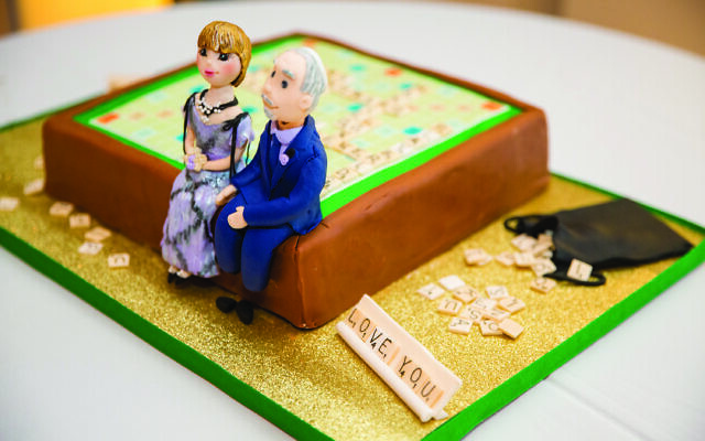 Scrabble groom's cake featuring the marzipan couple by Masterpieces by Marci. (Credit: Life on Film Photography)