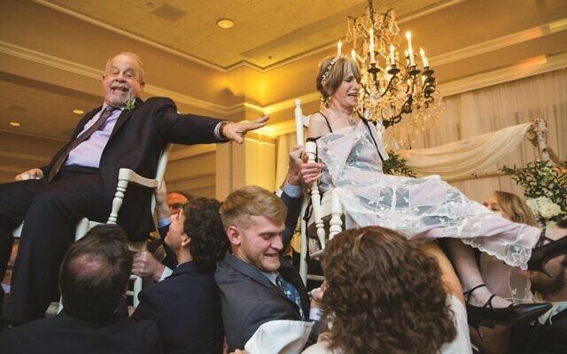 Howard and Sheila fly high during the customary hora to celebrate their union. (Credit: Life on Film Photography)