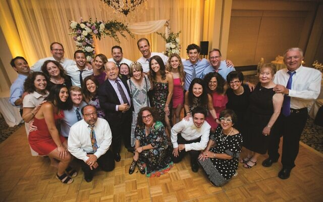 Extended family love! The children, grandchildren, nieces, nephews, cousins, aunts, uncles, and siblings of Howard and Sheila! (Credit: Life on Film Photography)