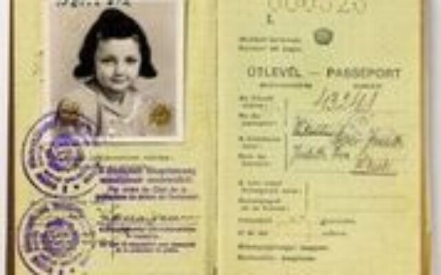 Eva Judith Weisz Moray was one of the children who traveled alone to escape Nazi Germany. Passport circa 1940. (Courtesy of The Breman Museum)