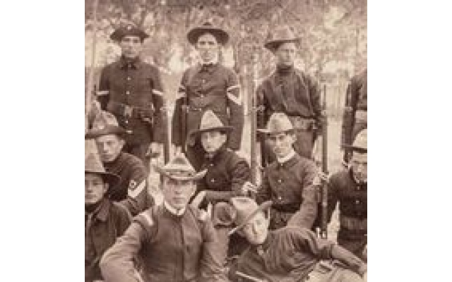 Sam Greenblatt (first on the left, standing) was 16 when he went to Cuba to fight in the Spanish-American War. His mother packed homemade bagels for him, and there was one still left when he came home. The family has passed the bagel down for six generations. Circa 1898. (Courtesy of The Breman Museum)