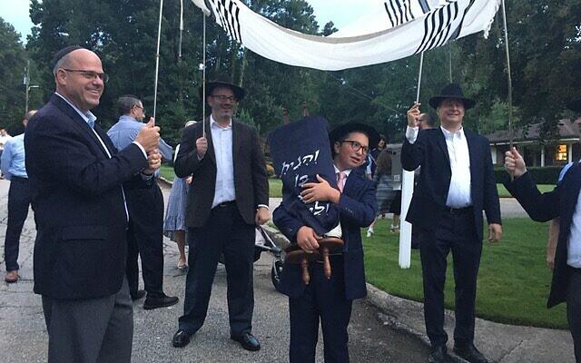 Photos by Allen H. Lipis // A tallit canopy accompanies the Torah procession.