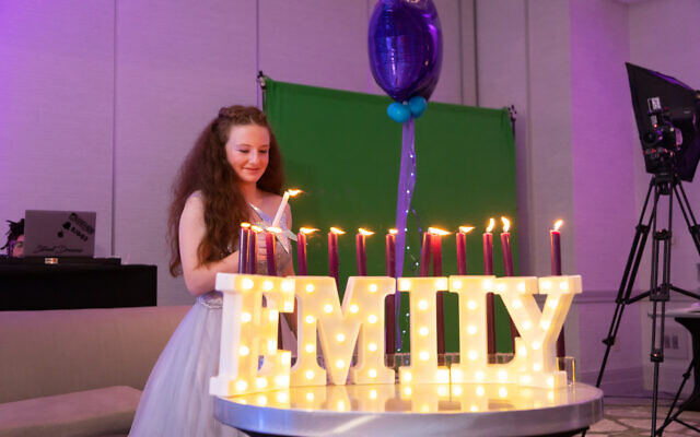 Photos by Revelry Photo House// Emily Tavani lights the candles.