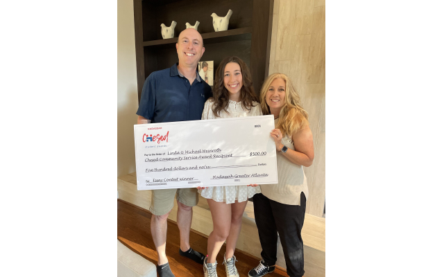 Ariel Goldt and her proud parents show the prize check.