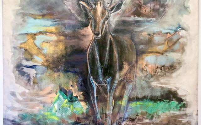 "Linda's painting of a winged antelope, ""Fierce Angel,"" on black fabric."