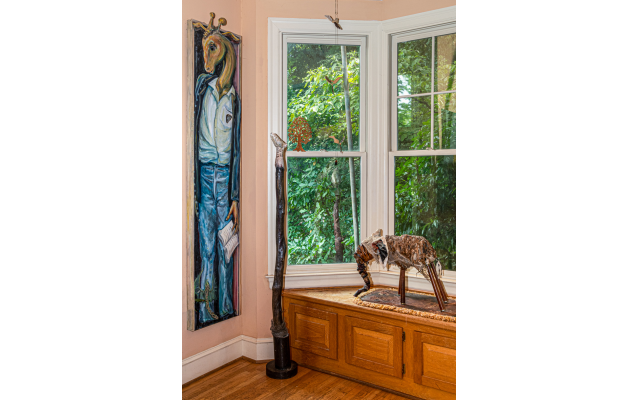 """A giraffe painted by Linda's friend John Seawright. The elephant sculpture made of wood and mixed media is called """"Treasure."""" The tall piece is """"Totem."""""""
