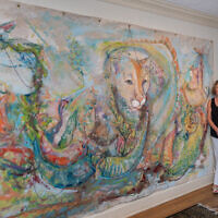 """Photos by Howard Mendel // Linda Mitchell painted """"Entropy: Wildcat"""" on fabric."""