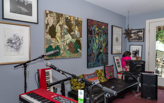 """The music room features a landscape photograph by David Armstrong, """"Study of a Violinist"""" by Lori Gene, """"Garden Party"""" by Andrew Catanese, and """"Low Country Boil"""" by Karen Tunnell."""