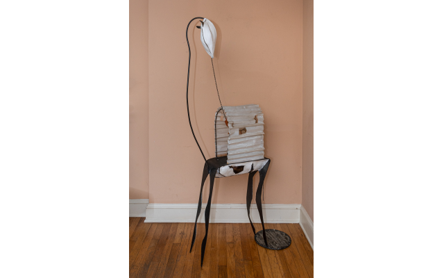 """Linda's 2001 mixed media sculpture """"Delicates"""" assembles an antelope out of welded steel, plaster, paper, and wood."""