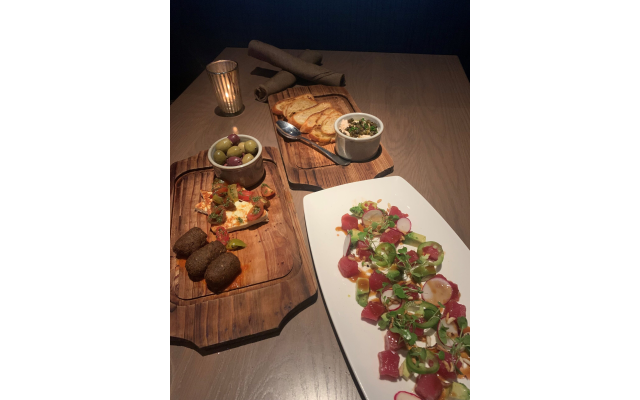 Globally inspired appetizers and table-pleasers: The Woodall Board — falafel, harissa, pan-fried queso, tomato and olives. Smoked Salmon Dip (table favorite). Poke Crudo.