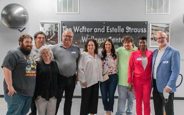 Dr. Scott Karlin (far right) and wife Jodi (flowered shirt) with Sandra Spielberger (center), Michelle Schwartz (far left), and family and friends.
