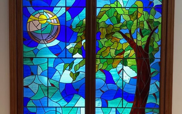 The newly installed windows at Temple Sinai were designed by Nancy Spanagel, a stained glass artist, and previously displayed at the Jacobs home.