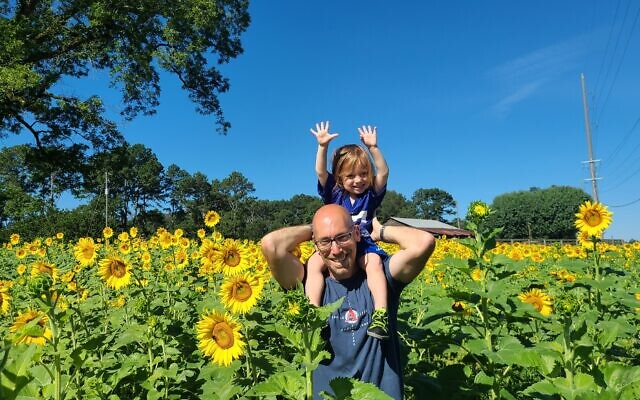 Mark Papier and son enjoy Anderson Family Farm in Cummings.