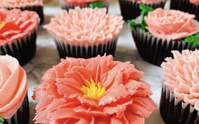 Cakeology's popular cupcakes topped with hand-piped buttercream flowers.