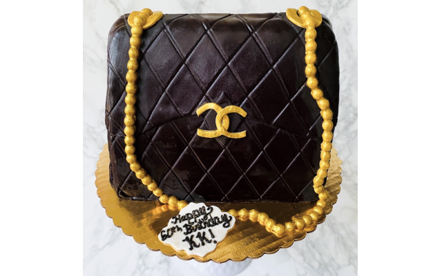 Chocolate cake with chocolate mousse carved in the shape of a purse for a birthday party.