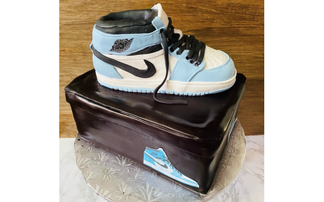 For a bar mitzvah, Marbach used mint chocolate chip cake covered in fondant to create this realistic sneaker, balanced on top of a shoebox made of marble cake.