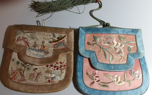 Antique Chinese flat purses, just big enough to hold a hankie and mirror.