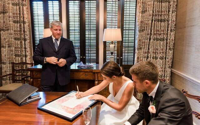 Photos by Mary Beth Marlow Photography // Signing the ketubah with Rabbi Laurence Rosenthal looking on.