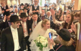 Photos by Joel Alpert/ Market Power // Guests rush up to sing and dance as they accompany newlyweds from the chuppah.
