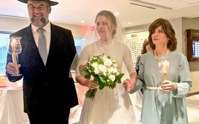 Photos by Joel Alpert/ Market Power // Rabbi Menachem and Dena Deutsch with Malka.