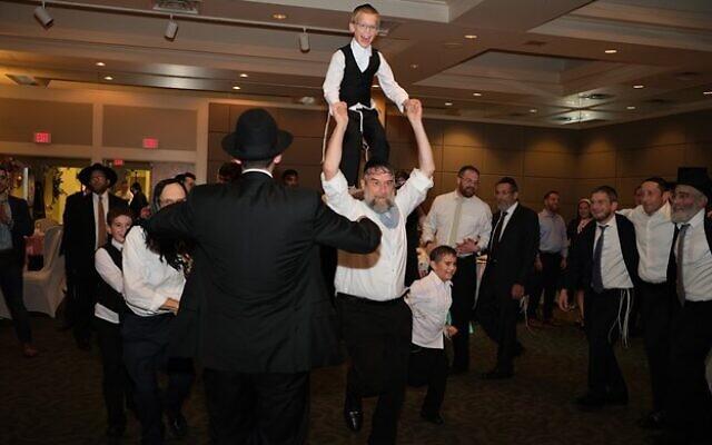 Rabbi Deutsch, with grandson, entertains the couple. Photo credit: Yaakov Meir Swiatycki//