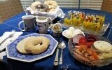 A traditional break-fast dairy menu includes lox and bagels with orange juice and hard-boiled eggs.