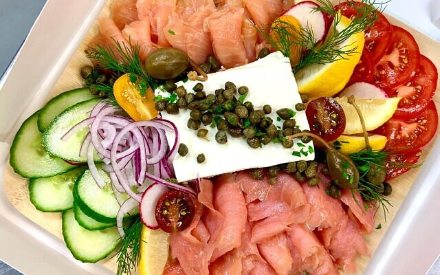 Added Touch Caterers share the Lox In A Box for individual Break-the-Fast enjoyment.