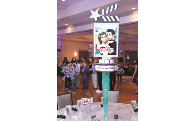 Photos by Revelry Photo House// Emily's love of movies and entertainment was reflected in colorful centerpieces.