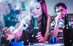 Teens drinking and smoking at a crazy party.