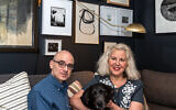 Photography by Howard Mendel// Robin Bernat and Jon Ciliberto enjoy time in their study with black lab Winnie. Robin's large mixed media drawing is based on the Book of Job (left).