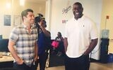 Adam Wexler, CEO of PrizePicks, shares a laugh with Magic Johnson.