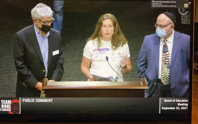 Flanked by Temple Emanu-El Rabbi Scott Colbert and Temple Kol Emeth Rabbi Emeritus Steven Lebow, Aviva Wolmer asked several questions of the Cobb County Board of Education.