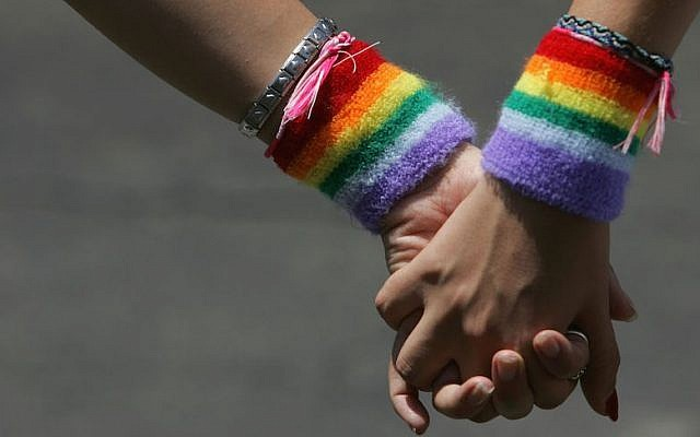 A lesbian couple hold hands during the Tel Aviv Gay Pride parade on June 3, 2016 (David Silverman/Getty Images via JTA, File)